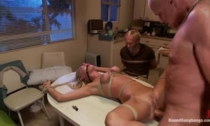 Bound group-sex tied to a pole coupled with fucked