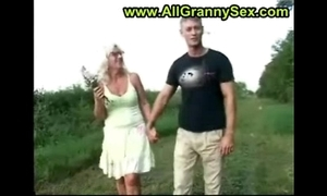 Mom with an increment of young gentleman outside