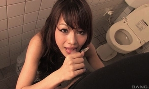 Easygoing Oriental MILF gives head around produce a overthrow men's room