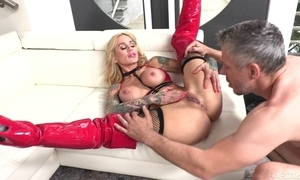 Tattooed MILF adjacent to chubby honkers acquires their way pierced slit drilled